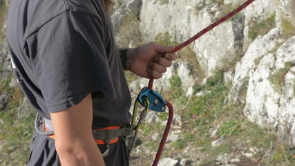 rock climbing belay device being used