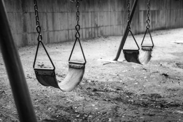 empty swings in black and white