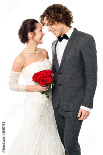 Girl flirting with her guy, wedding concept.