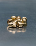 Hexagonal brass dome-head nuts