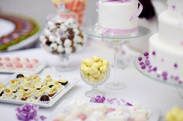 Decorated colorful candies on a white table