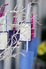 Colorful cards on a silver tree
