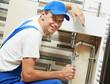 Leinwanddruck Bild - Young smiling plumber man worker