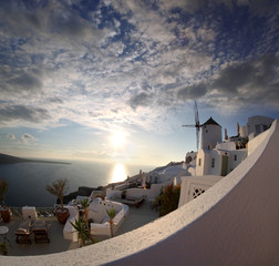 Windmill in Santorini against sunset, Greece, Oia village