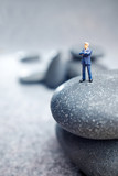 Business miniature  figures and rocks