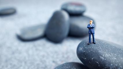 Business miniature  figures and rocks