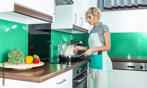 Young woman cook or housewife
