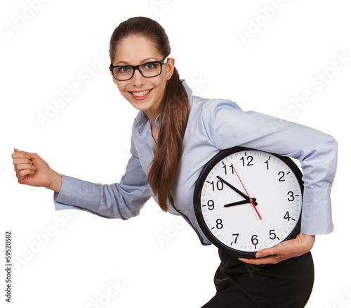 Girl with glasses runs with a clock in his hands