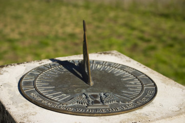 Bronze sundial with inscription and shadow