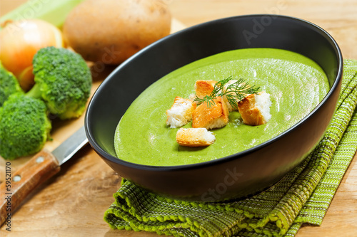 Broccoli cream soup and ingredients on table