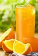 Orange juice on the wood surface, outdoor