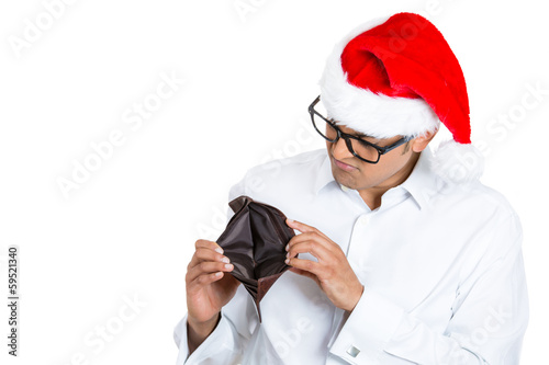 Broke christmas man showing his empty wallet