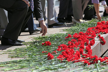 Laying flowers at memorial