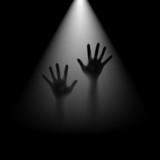 Hands in backlight.