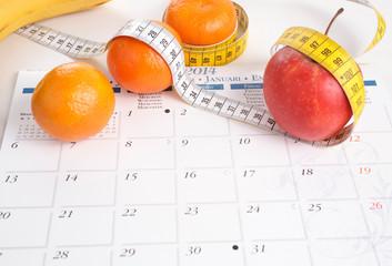 Obst, Maßband und Kalender