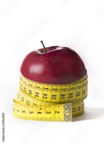 Apple wrapped in tailor tape isolated on white background
