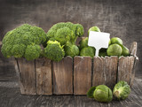 Assortment cabbages on wooden background