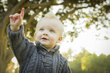 Pointing Blonde Baby Boy Outdoors at the Park.