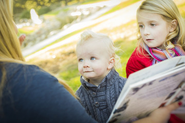 Mom Reading a Book to Her Two Adorable Blonde Children.