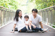 chinese asian pregnant mother and family outdoor photo