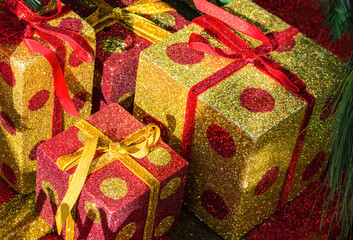 Bright gift boxes by christmas tree