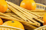breadsticks and mandarins on wooden background