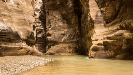 Flowing river in canyon of Wadi Mujib, Jordan