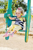 swinging toddler girl
