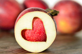 Red apples with heart symbol.Love fruit concept, love diet.