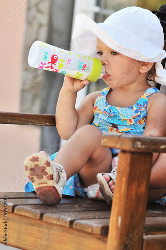 toddler with bottle of milk