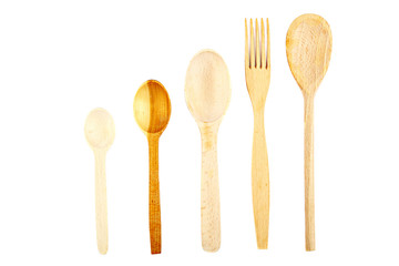 Wooden kitchen utensils on white background.