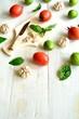 Tomato,basil and garlic with cutting board