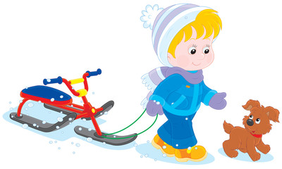 Child walks with a snow scooter and pup