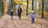 Family walking in woods