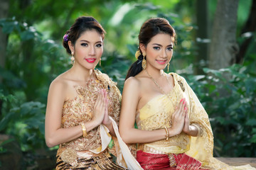 Two Thai woman wearing typical Thai dress