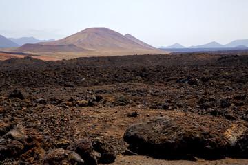 volcanic  lanzarote  spain  timanfaya  rock  sky  hill and summe
