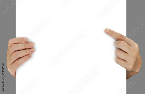 Hands pointing on blank white paper isolated over grey