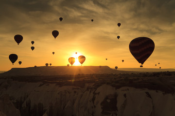 Balloons in Cappadocia at dawn sky background