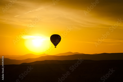 Balloon in Cappadocia at dawn sky background