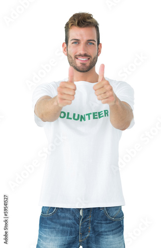 Portrait of a happy male volunteer gesturing thumbs up