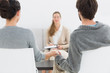 Blurred financial adviser in meeting with couple