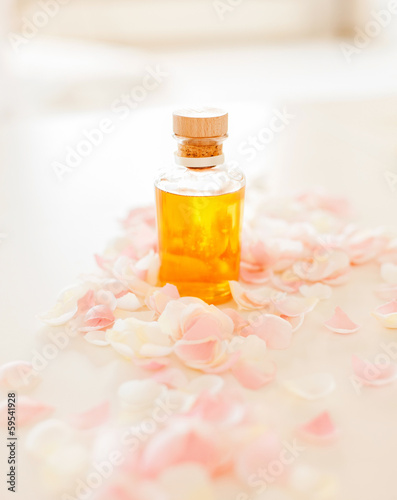 closeup of essential oil and rose petals