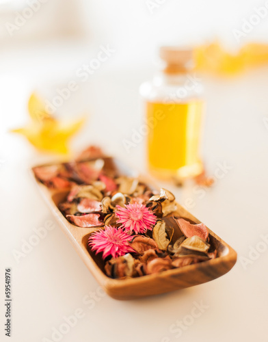 closeup of essential oil, flowers and pot-pourri