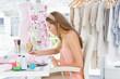 Female fashion designer working on her designs