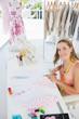 Young female fashion designer working on fabrics