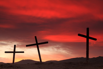 Crosses on a hill at sunset