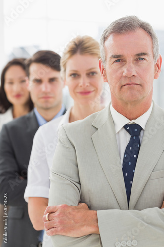 Business team standing in a line looking at camera