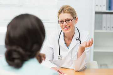 Smiling doctor talking to her patient