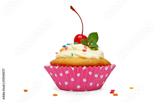 Vanilla cupcake with cherry and mint on top