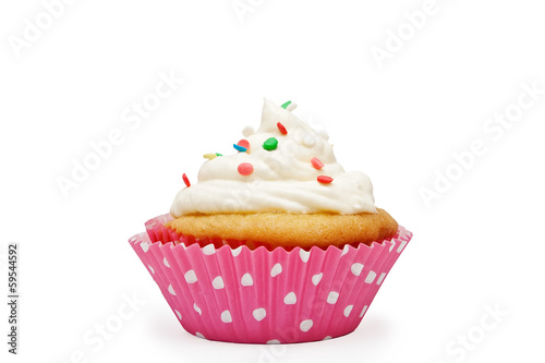 Vanilla cupcake with custard in the pink polka dotted paper cup